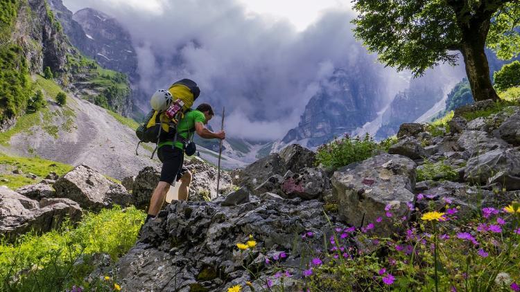 Luka Krajnc approaches the 700-meter limestone face of Papignut. © Marko Prezelj